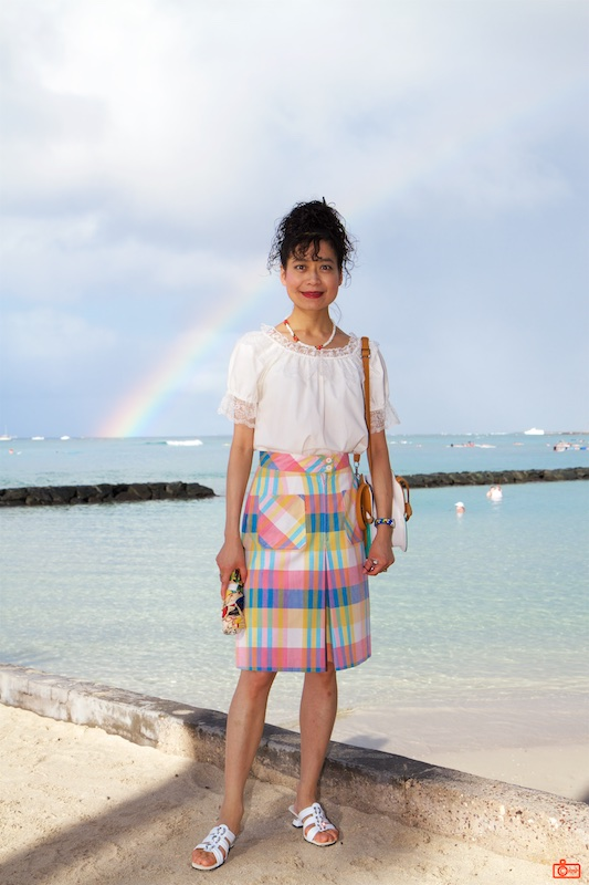 Rosa in front of a late afternoon rainbow over the beach at Waikiki.